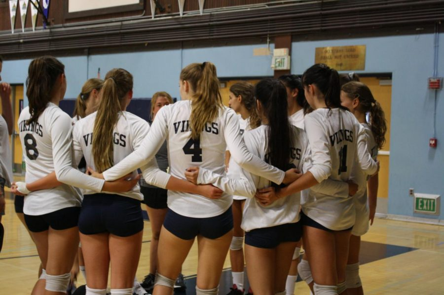Oakmont+girls+volleyball+team+huddling+together+to+plan+their+next+play