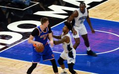 Kristaps Porzingis looking to post up Elfrid Payton (photo by Jose Garcia)