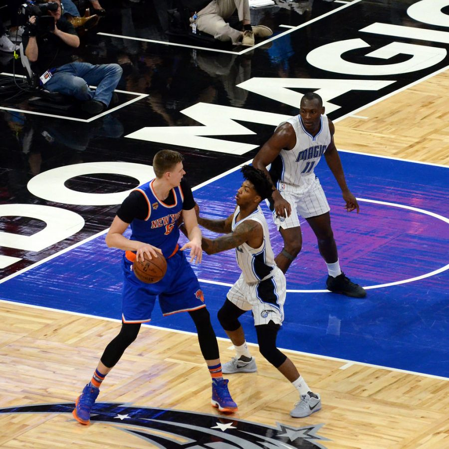 Kristaps+Porzingis+looking+to+post+up+Elfrid+Payton+%28photo+by+Jose+Garcia%29