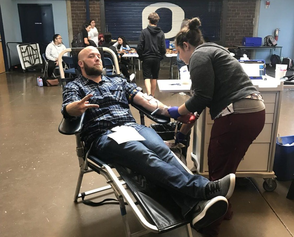 Mr. Henry donating his blood to save lives.