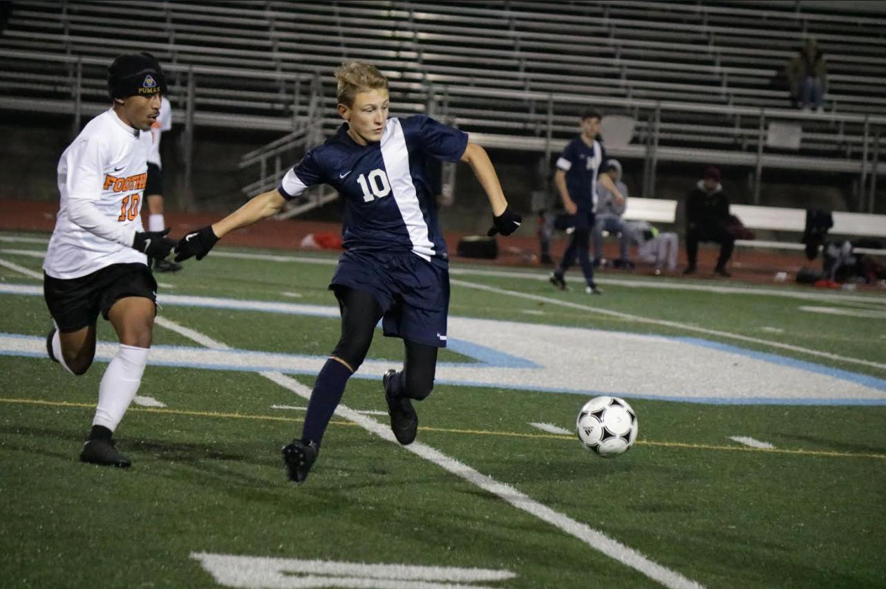 Freshman Carson Dubay defending Oakmont's soccer team to a win!