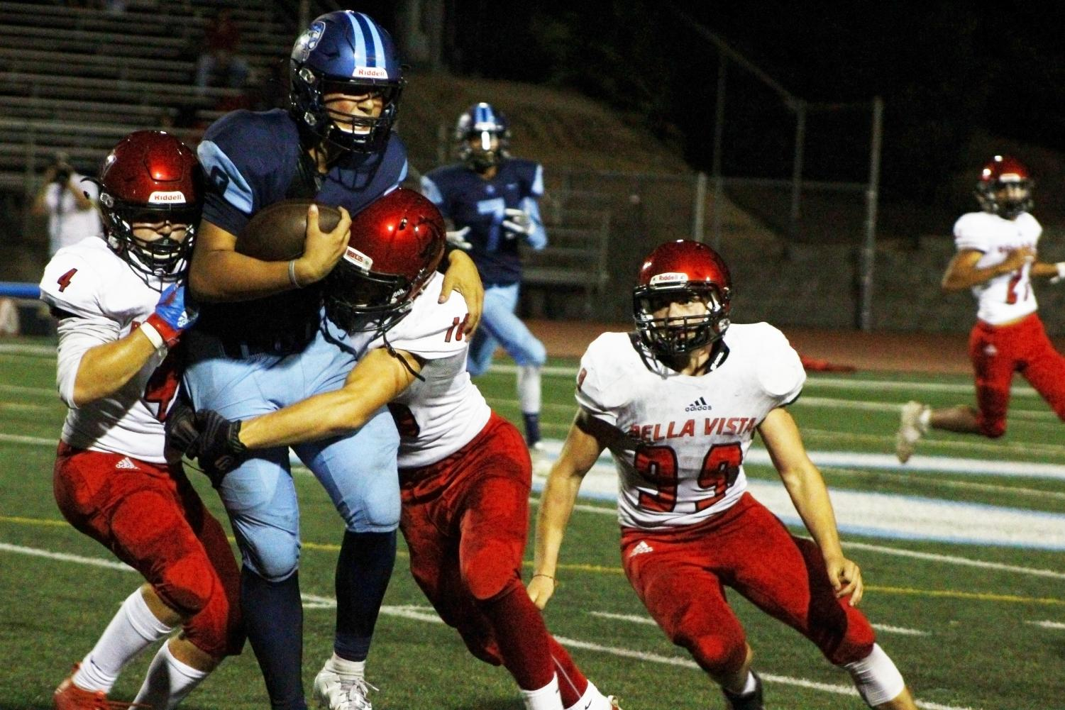 Hayden Abbruzzese withstanding the power of opposing football players.