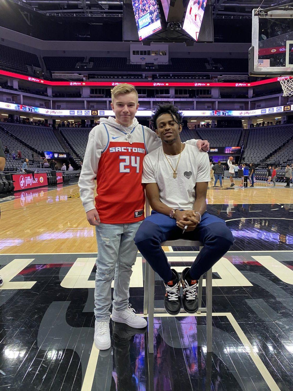 Freshman Noah Rush with Sacramento Kings point guard De'Aaron Fox.