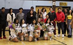 The varsity girls' basketball seniors line up for a final photo with their friends and families (from left to right): Preet Gill, Sophia Piepmeier, Jada Holmes, Maddison Hasegowa, and Kiona Prout