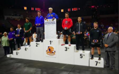 Junior Sean Myles (far right) on the winner's podium after taking seventh place at the CIF State Wrestling Championship.