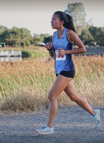 Junior XC athlete Lois Sison racing in a meet before the pandemic started.