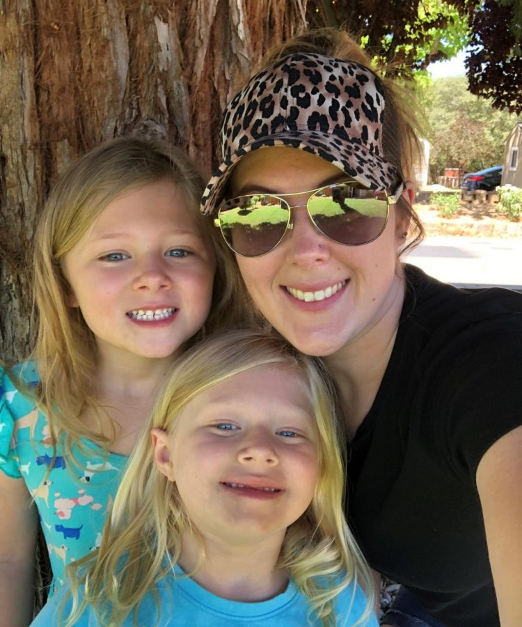 Jordan Tibbits poses on the right with her two daughters.