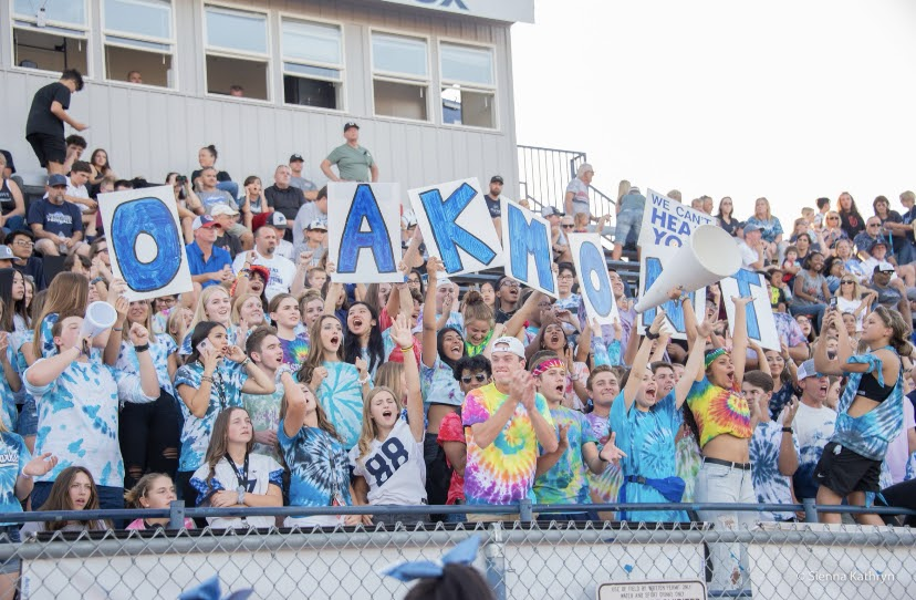 Last year's Oakmont O-Zone cheering on the varsity football team during the tie dye themed game.
