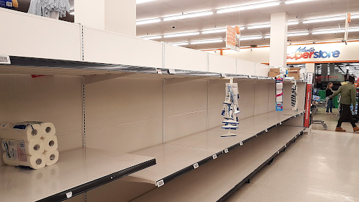 Shelves that usually held toilet paper were nearly empty because of the panic buying that occurred throughout the United States.