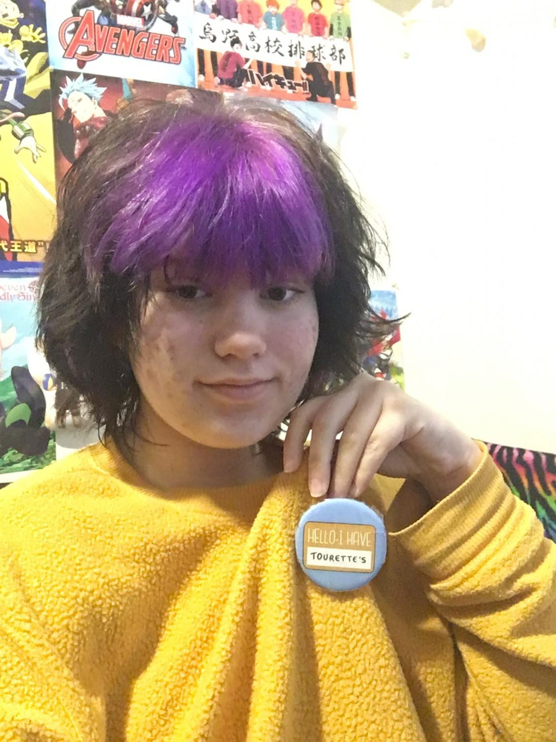 "Isabel with her pin that says ""Hello, I have Tourette"