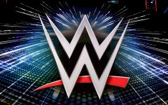 A WWE logo is shown on a screen before a news conference October 11.