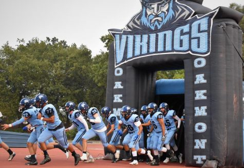 The Oakmont varsity football team make their entrance into the first game of the year.
