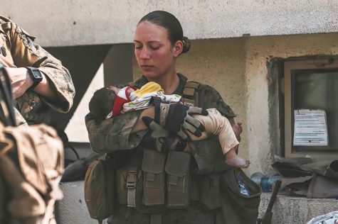 Sgt. Nicole Gee pictured on her Instagram cradling a baby in Kabul, Afghanistan on Aug. 20.