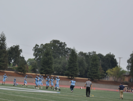 During the Oakmont VS Roseville football game, athletes were playing through the hazy air.