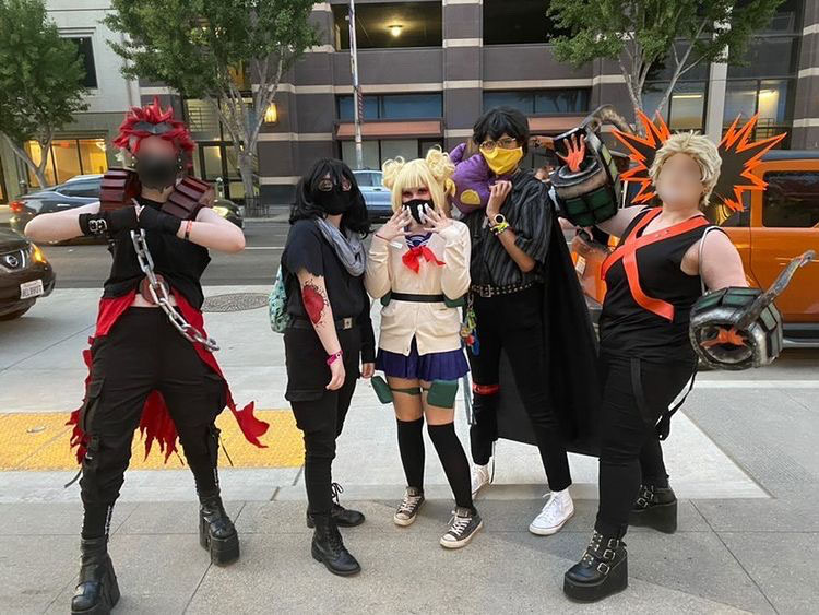 """Outside of the convention center, Henderson [middle] is pictured with their friends, Kelsey Davis [middle left] and Kennedy-Jade Green [middle right], as well as two other cosplayers they met at the convention, all cosplaying as characters from """"My Hero Academia."""""""
