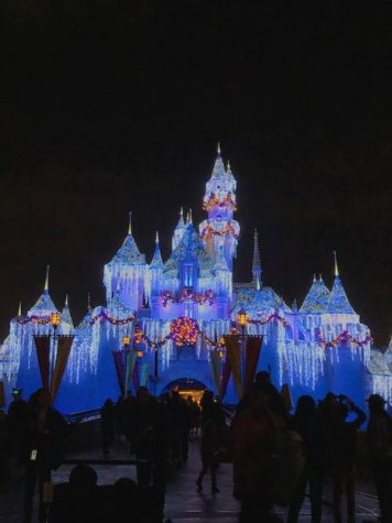 The Disneyland castle dressed up for Christmastime showing the magical appeal of Disney.