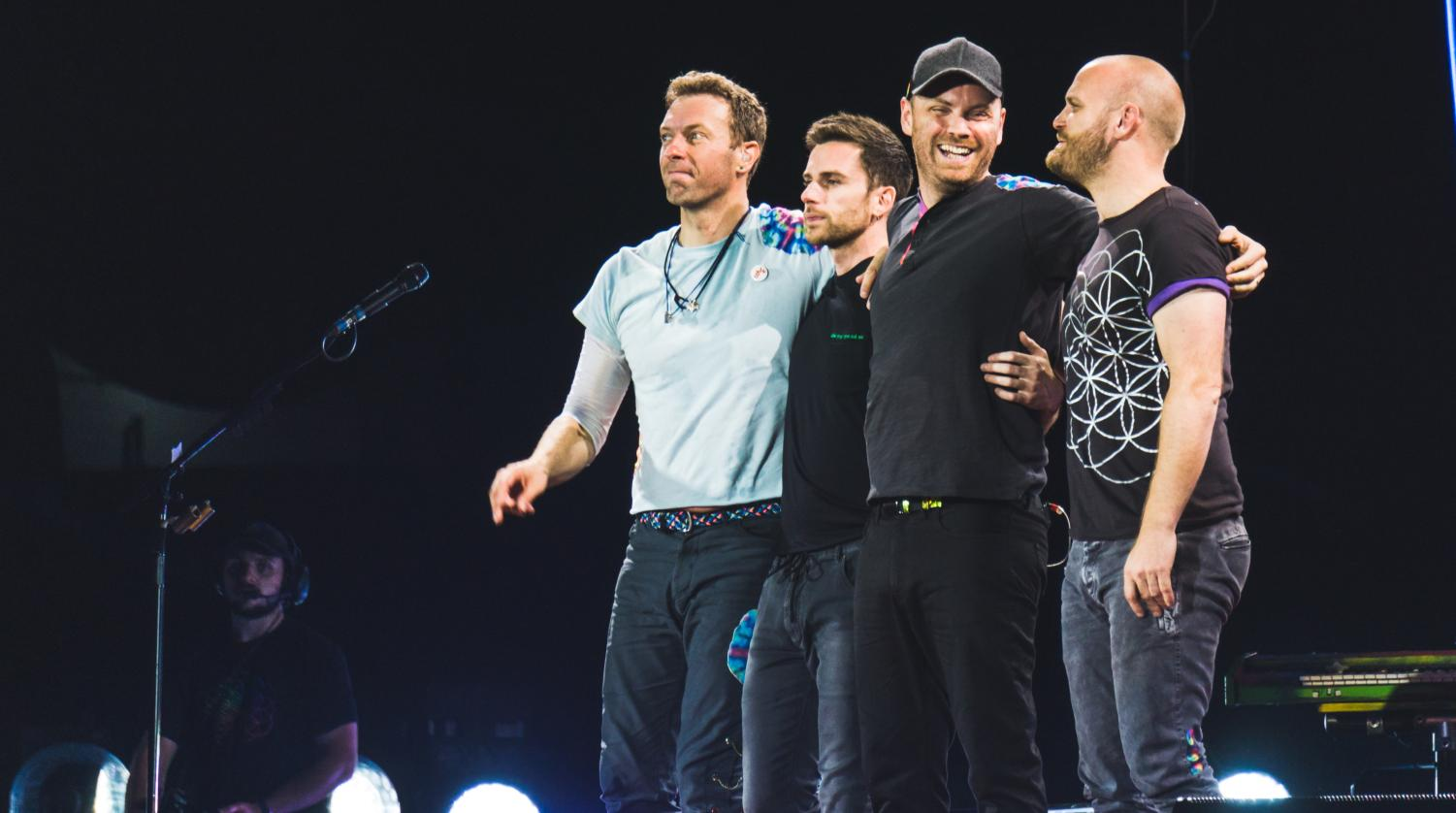 British band Coldplay performing a concert in 2017.